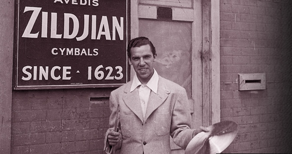 "Drum legend Buddy Rich outside of the Avedis Zildjian cymbal factory in Quincy Massachusetts, September 20, 1938. The night before, as a member of Bunny Berigan's band, he played the opening of a prestigious two-week engagement at the roof garden of Boston's Ritz Carleton Hotel. The next night, the great hurricane of 1938 struck Boston and blew the Berigan band out of work for several days. Rich once told me: ""playing with Bunny Berigan's band was my first big-time jazz gig. He was a hell of a musician, and his band was one of the best in the business then."""